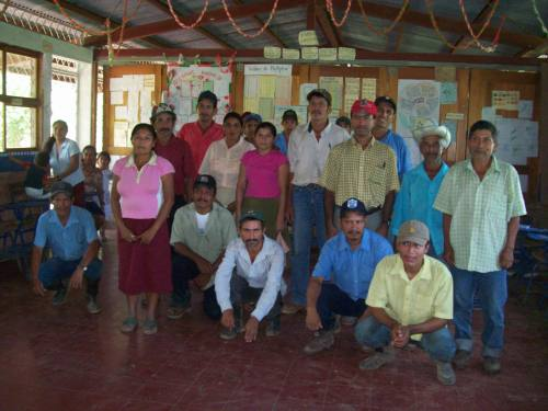 This photo is of the community Zinica I taken in September 2009. The community members, household beneficiaries and the Water Board meet to discuss the community fund with the Water Ministry Staff