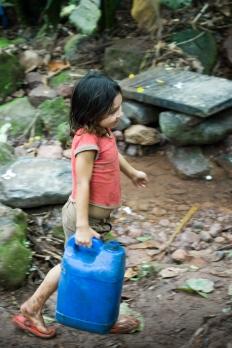 Girl carries bucket